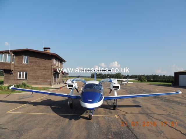 a twin-engine four seater V-24-I